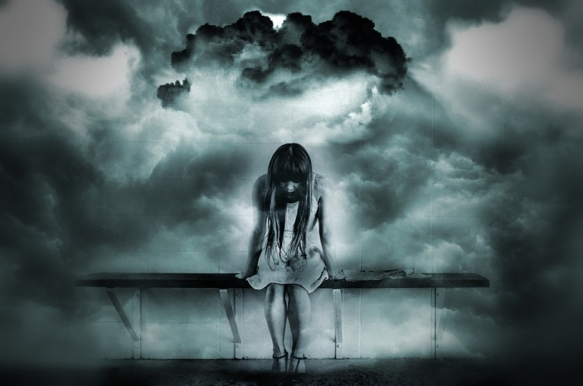 dark clouds over sad girl sitting bench